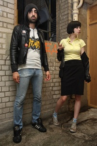 Ethan Kath and Alice Glass of Crystal Castles stand in an alley