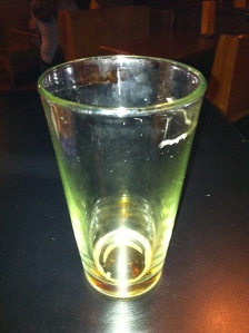 an empty glass that once contained Bell's stout ale